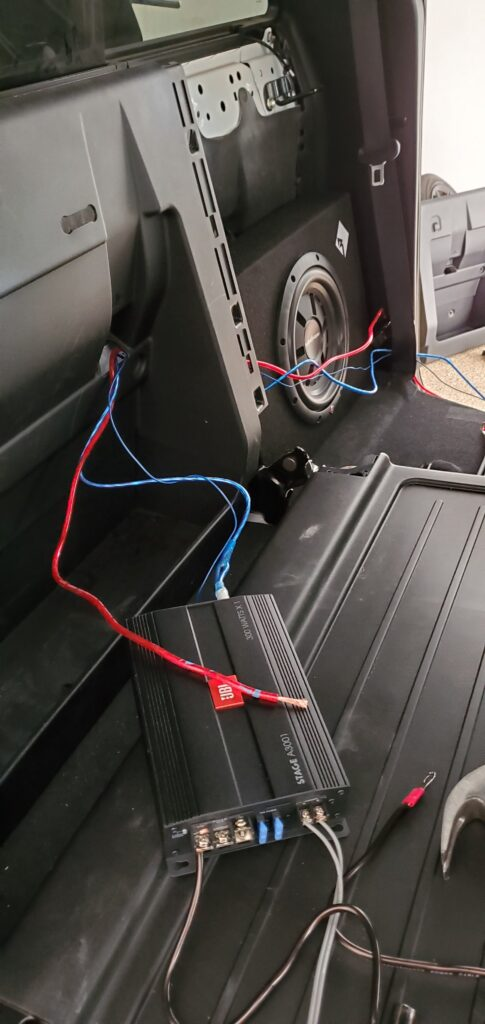 wiring up the amp and sub behind the back seat